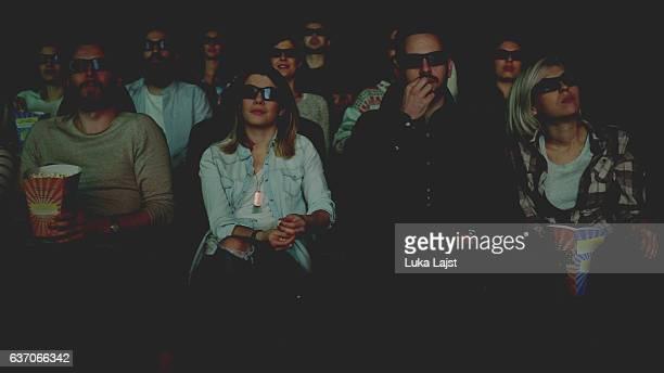 happy people enjoying in the cinema watching  movie