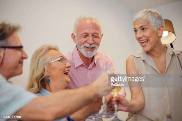 Happy people having celebratory toast
