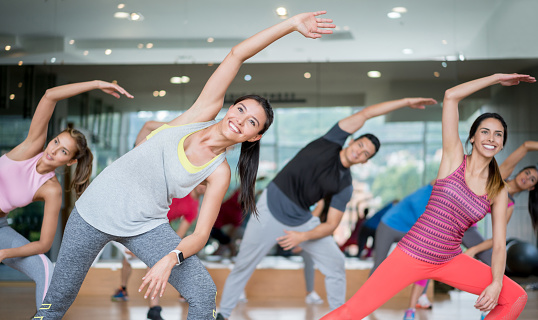 Happy people in an aerobics class at the gym 841069776