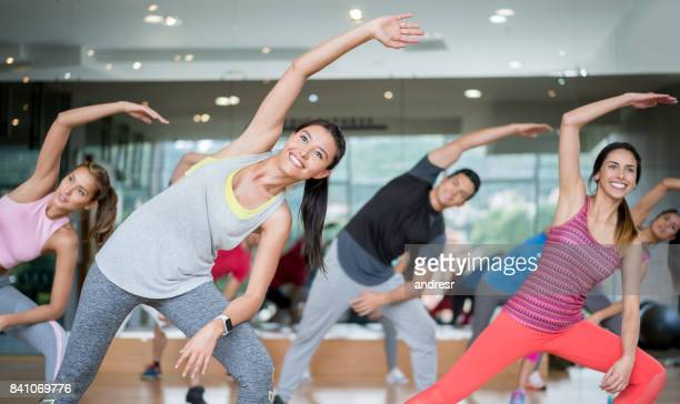 Happy people in an aerobics class at the gym