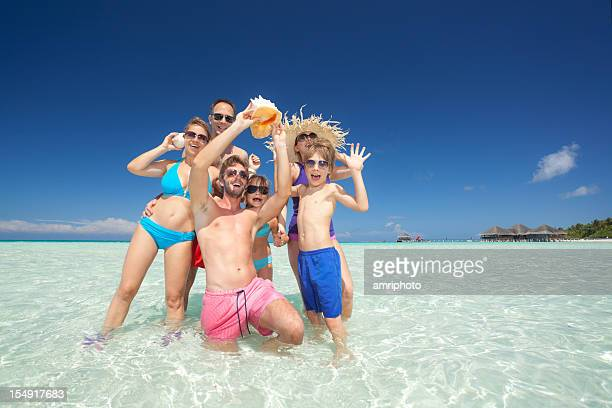 happy people in tropical lagoon