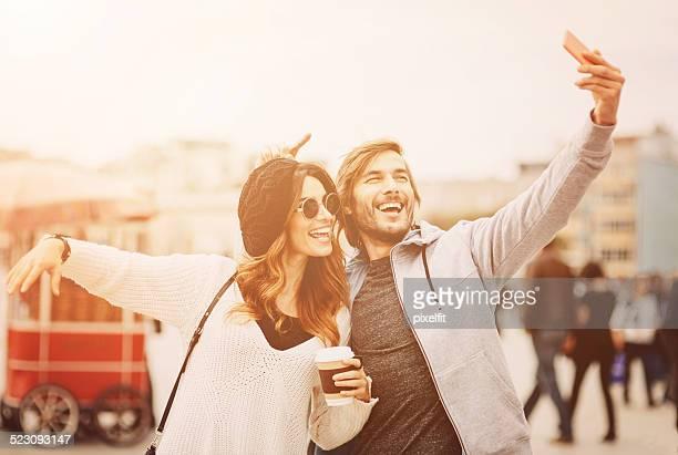 Happy People making selfie on the street