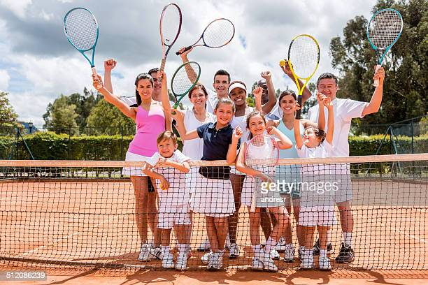 Happy people playing tennis