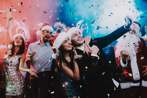 Happy People Taking Selfie on New Year Party. 1053322410