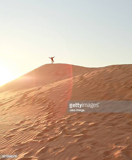 happy person on sand dune, walvis bay, namibia - jake warga stock pictures, royalty-free photos & images
