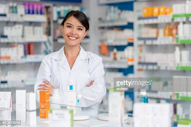 Happy pharmacist working at a drugstore
