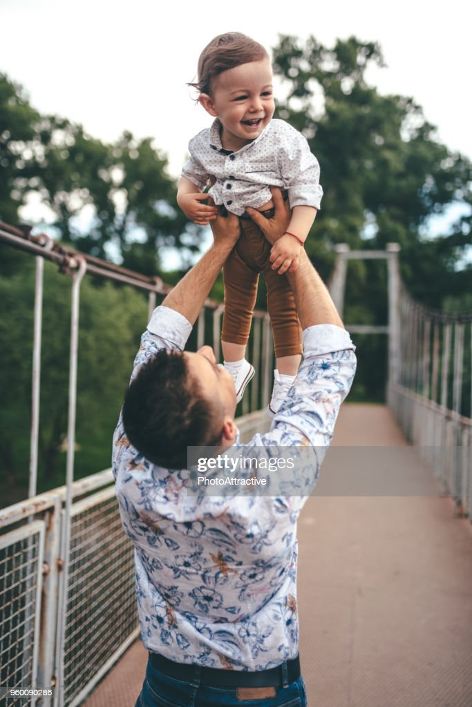 Happy photo father and child having fun outdoors : Stock Photo