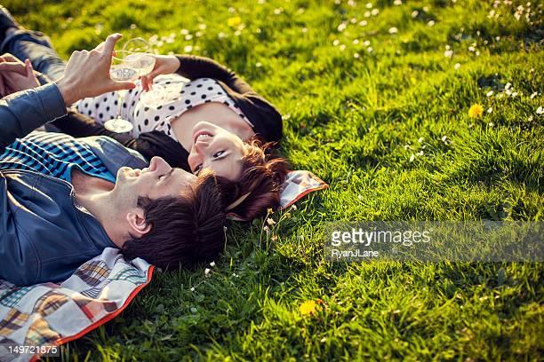 Happy Picnic Couple with Wine Glasses