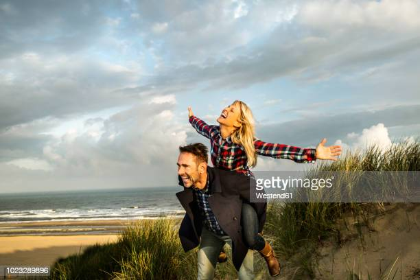 Happy playful couple in dunes