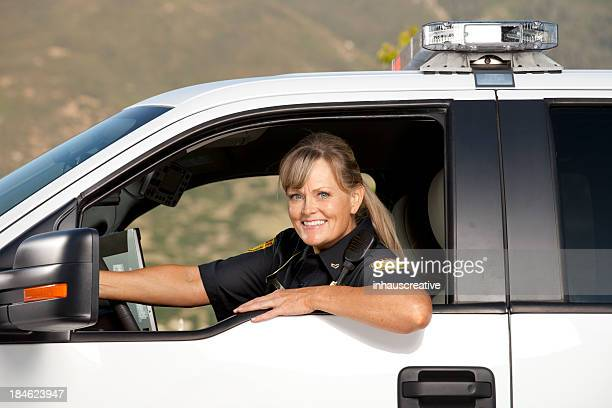 Happy Police Officer Driving Policecar