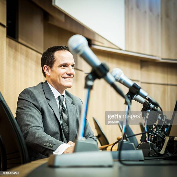 happy politician at the auditorium - mayor stock pictures, royalty-free photos & images
