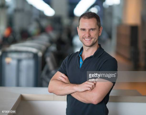 happy portrait of a business owner at the gym - leisure facilities stock pictures, royalty-free photos & images