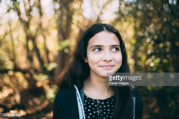 happy portrait of a young teen girl outside looking to her left - thousand oaks stock pictures, royalty-free photos & images