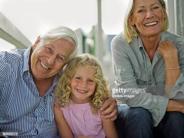 Happy portrait of grandparents and granddaughter