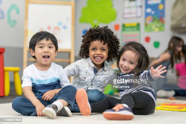 happy preschool friends - preschool age stock pictures, royalty-free photos & images