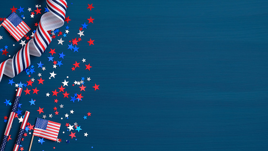 Happy Presidents Day concept. Grosgrain ribbon, American flags and confetti stars on blue background with copy space. Web banner template for USA Independence day or Memorial Day. 1198052802