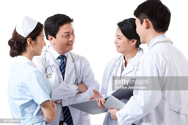 Happy professional medical team in discussion