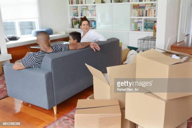 happy proud mother and her family relaxing in their new home - rafael ben ari stockfoto's en -beelden