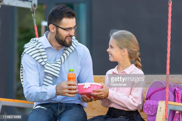 happy pupil father schoolyard