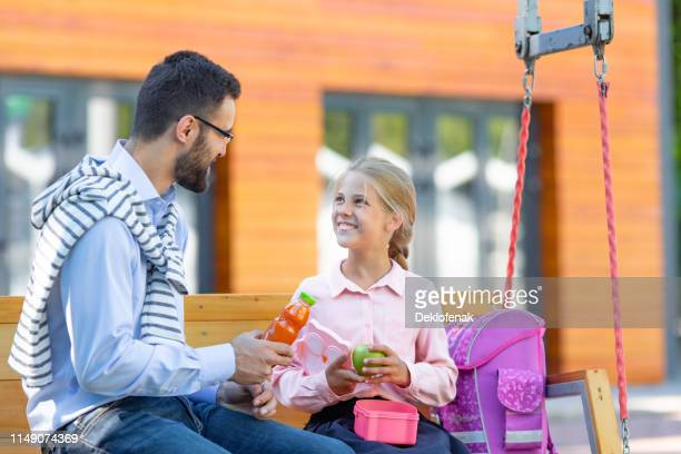 happy pupil father with lunch schoolyard