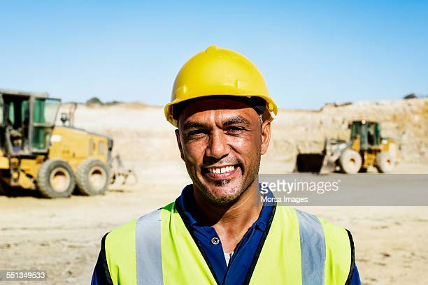 happy quarry worker at construction site - reflective clothing stock pictures, royalty-free photos & images