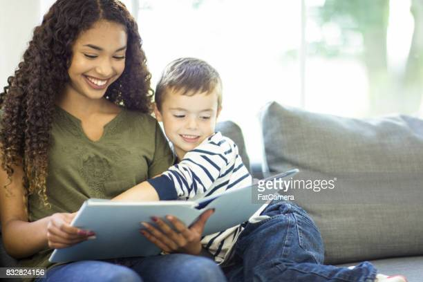 happy readers - nanny stock photos and pictures