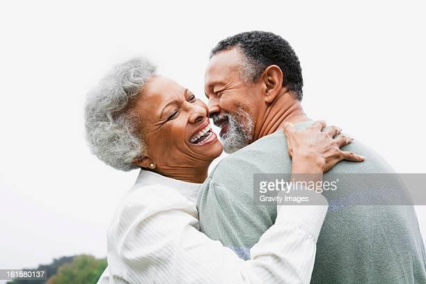 Happy retired couple embracing