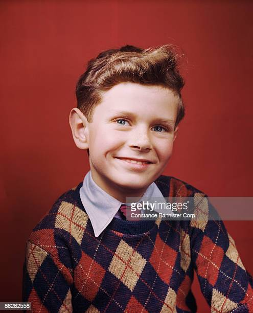 Happy retro boy wearing argyle pattern sweater