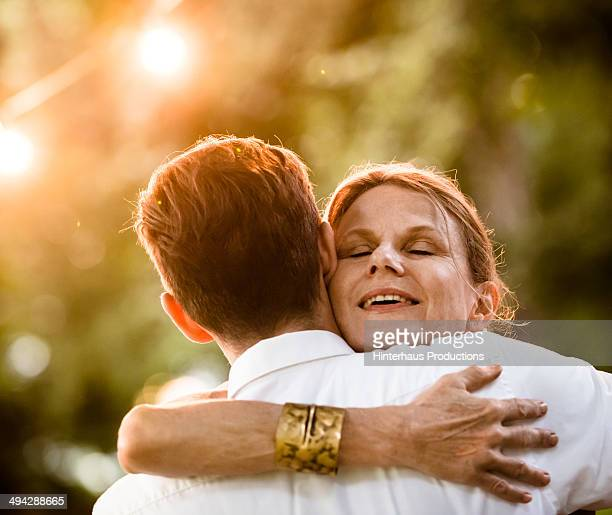 happy reunion - mother and son stock photos and pictures