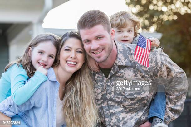 happy reunion - military flags stock photos and pictures
