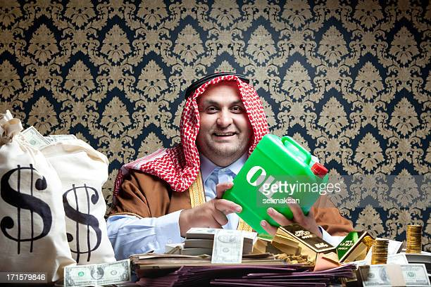 Happy rich arab sheik and his dollars, gold, oil
