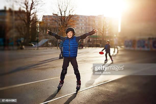 happy roller skating boy