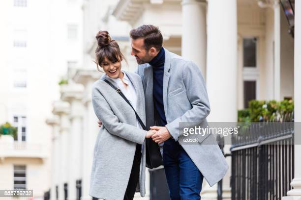 happy romantic couple flirting in the city street - a fall from grace stock pictures, royalty-free photos & images
