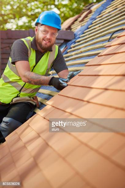 happy roofer portrait - membrane stock photos and pictures