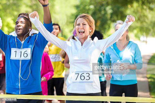 Happy runners celebrating as they win marathon or 5k race