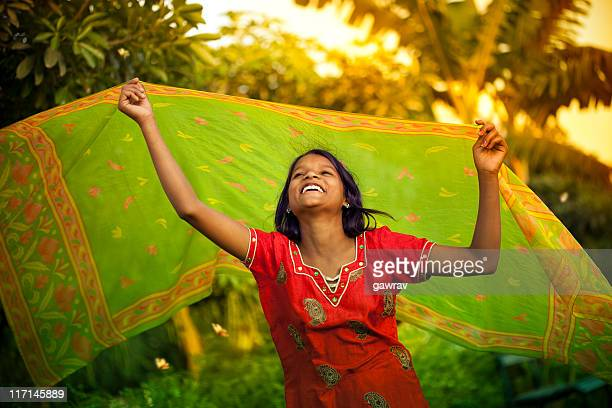 happy, rural indian girl dancing in natural environment - dupatta stock pictures, royalty-free photos & images