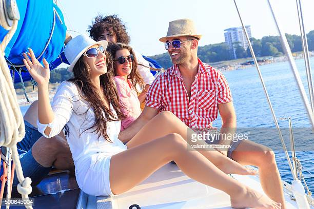 Happy sailing crew on boat