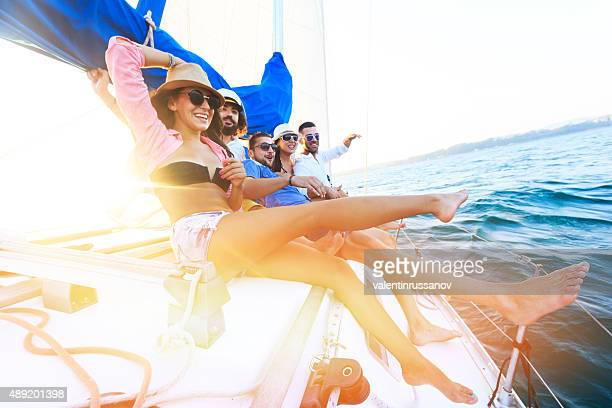 Happy sailing crew on sailboat