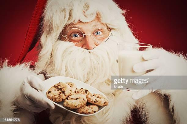 Happy Santa Claus and cookies milk