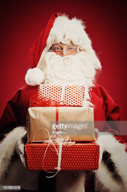 Happy Santa Claus isolated on red