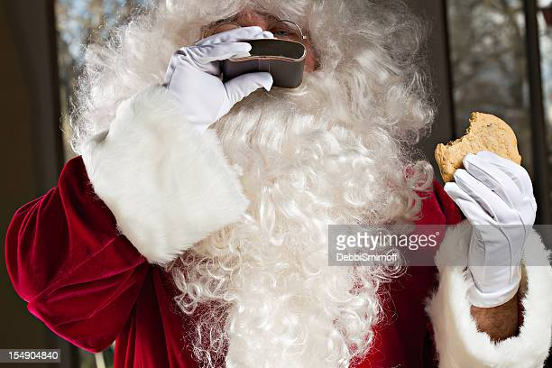 happy santa with cookie - naughty santa stock photos and pictures