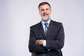 Happy satisfied mature businessman looking at camera isolated on white background.