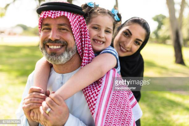 happy saudi arabian family in the park
