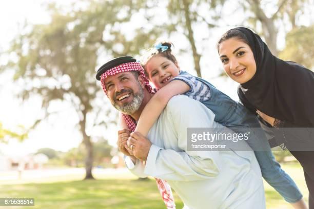 happy saudi arabian family in the park