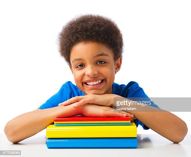 Happy school boy with books