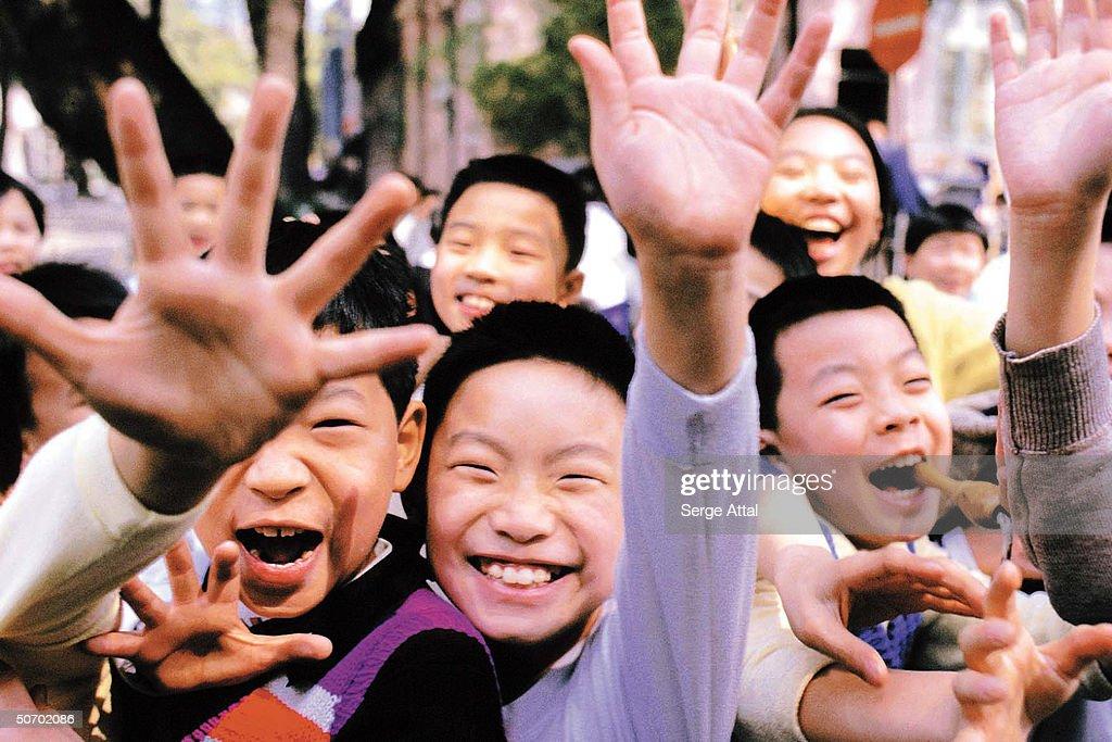 Happy school boys waving.