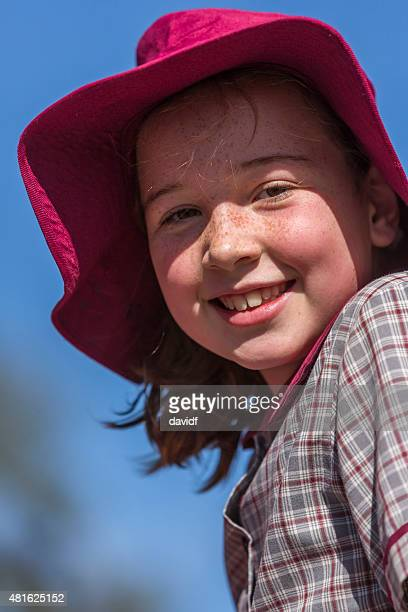 Happy School Girl in a Sunny Playground Wearing a Hat