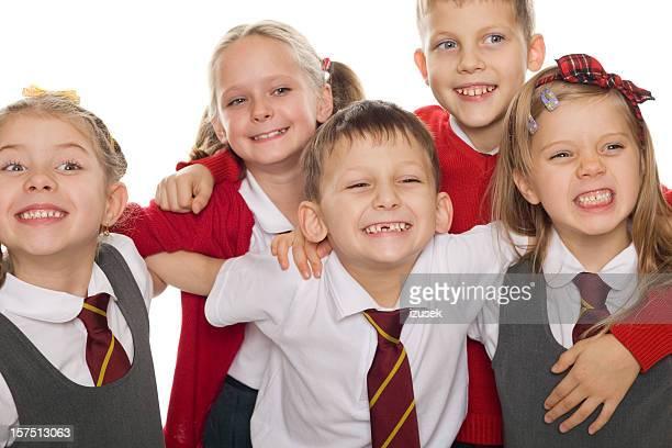 Happy School Kids Showing Teeth, Studio Portrait