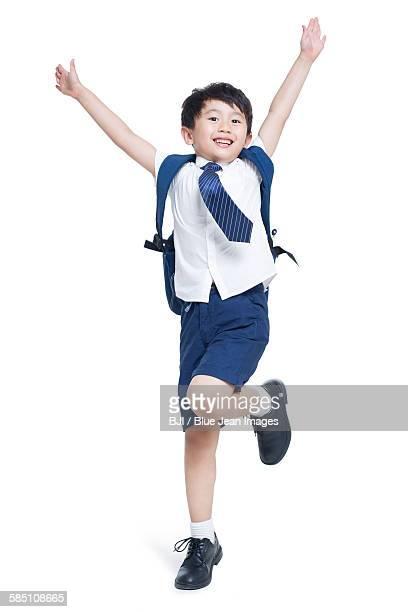 Happy schoolboy jumping