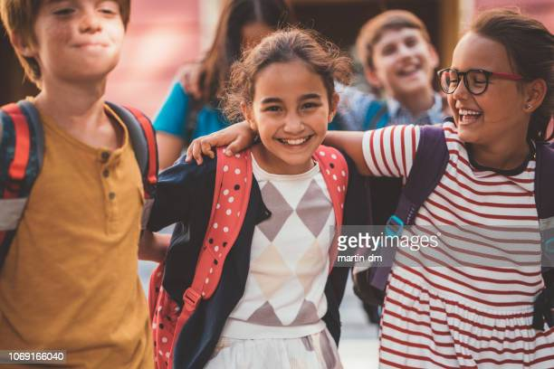 happy schoolchildren's portrait - elementary school stock pictures, royalty-free photos & images